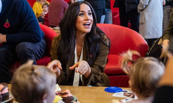 Meghan Markle playing with children at the centre