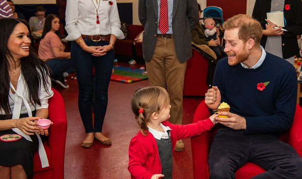 Meghan and Prince Harry playing with children of serving soldiers