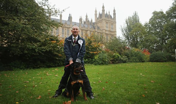 Sir Lindsay outside the Palace of Westmisnter with his rottweiler Gordon