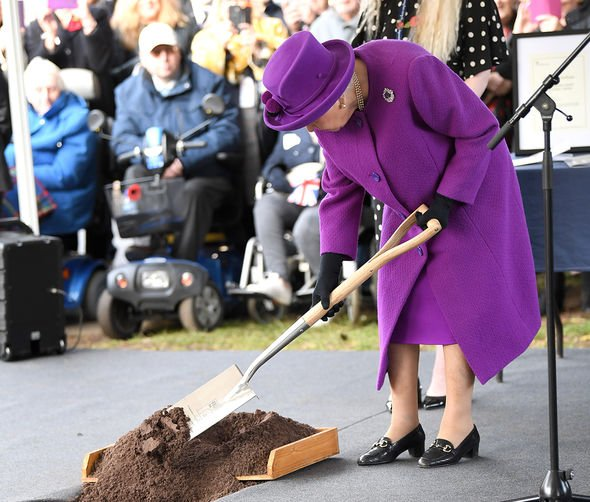 The Queen burying a time capsule