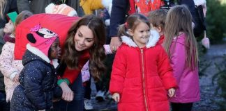 Kate was dressed in festive colours as she visited the farm Image GETTY