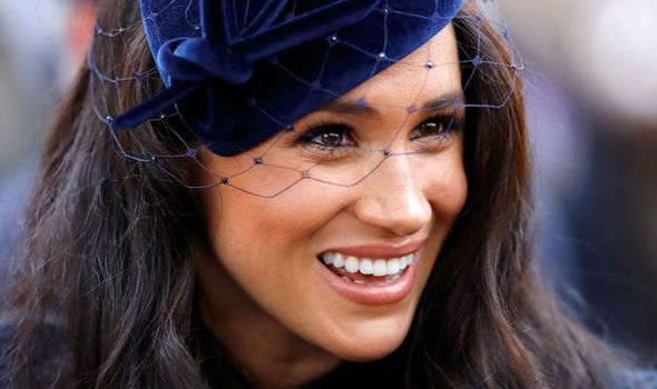 Meghan Markle smiling during an engagement
