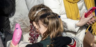 Princess Charlotte melts hearts as she warmly embraces well wishers during Christmas Day walkabout Photo C GETTY