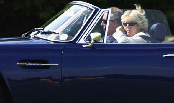 Charles and Camilla in his Aston Martin in 2003