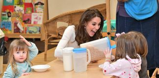 The Duchess of Cambridge has been dubbed the 'children's princess' after delighting families on a string of heart-warming engagements. Pictured, Kate in a jovial mood as she served breakfast to two young girls atStockwell Gardens Nursery & Pre-School, London, yesterday
