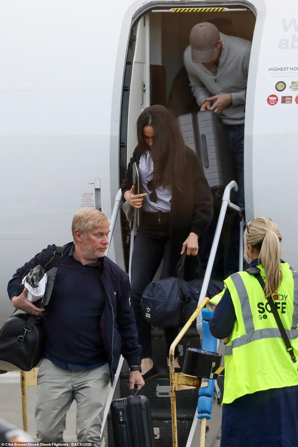Meghan also opted for an eco-friendly outfit for the flight. The Duchess, who led the way out of the plane with her husband following closely behind, wore 5 black pumps from Rothy's, a San Francisco-based company that turns recycled water bottles into shoes and was carrying a ,790 duffle bag from Prada's Re-Nylon line, which uses the material Econyl