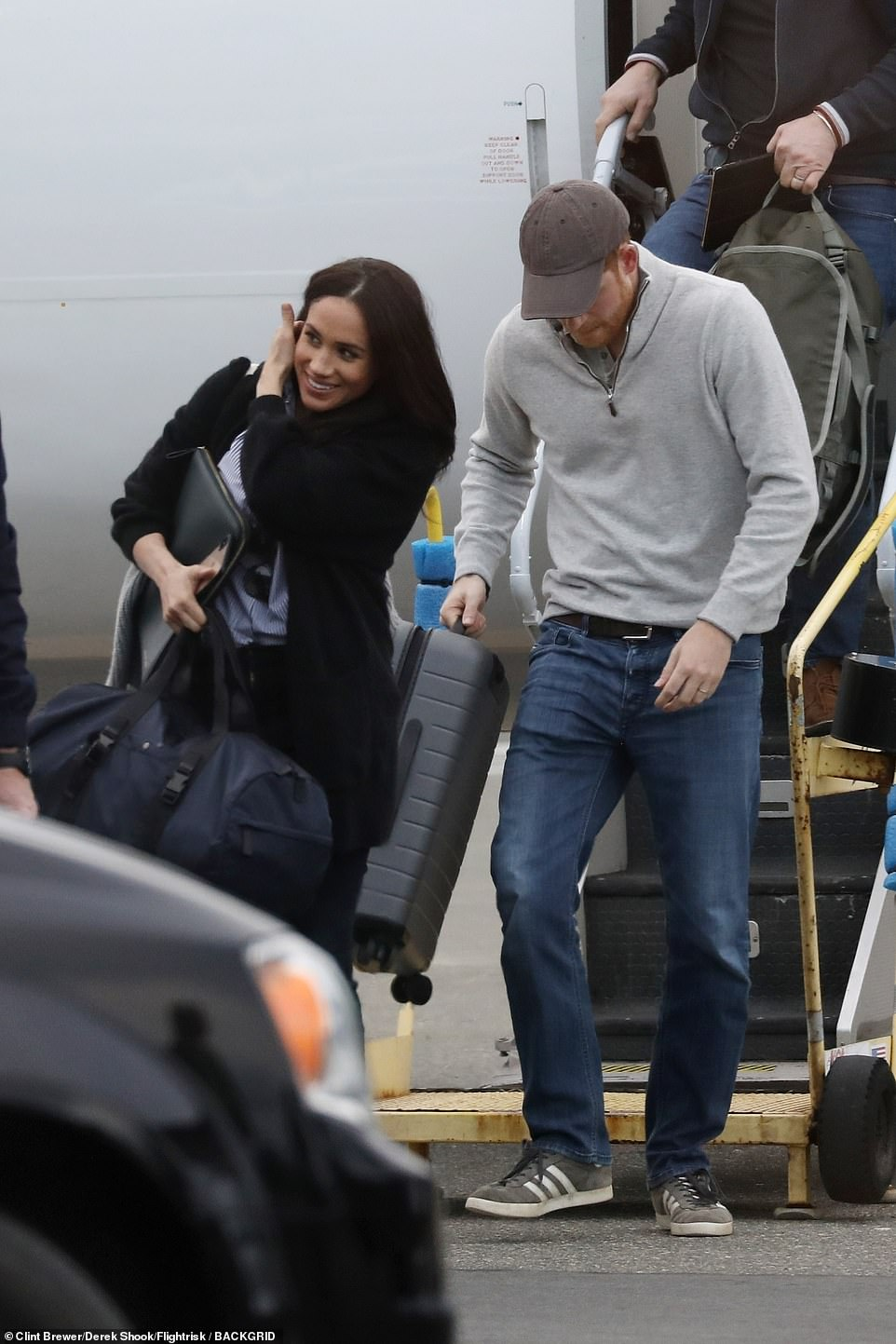 In a departure from their Royal ways, Harry and Meghan carried their own cabin bags off the commercial flight. The couple have previously been slammed for preaching about saving the planet, and then flying around the world by private jet