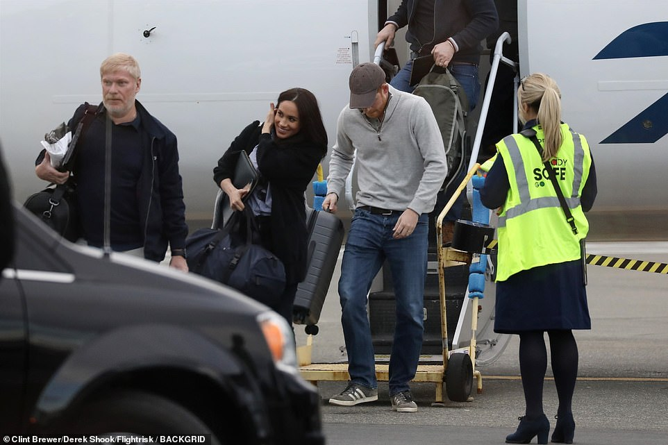 The Royal couple were all smiles as they landed in Canada after taking a flight from the US, in pictures obtained exclusively by DailyMail.com. They touched down at Victoria airport at around 4:45 pm Friday, with what appeared to be a small group of security