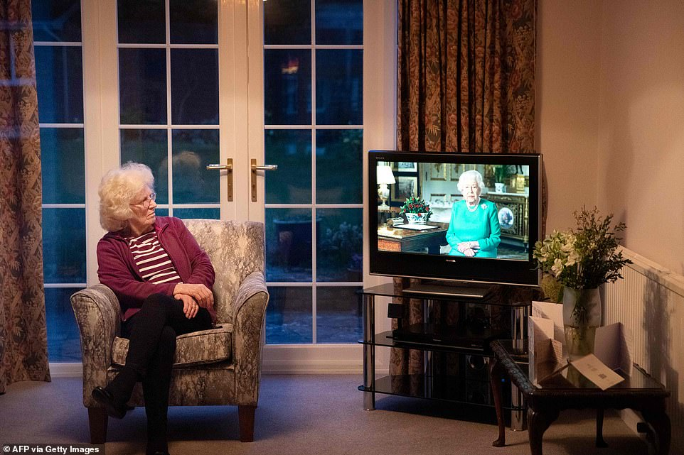 Val Cloke sits in her living room in the village of Hartley Wintney, west of London, watching the Queen's historic address tonight