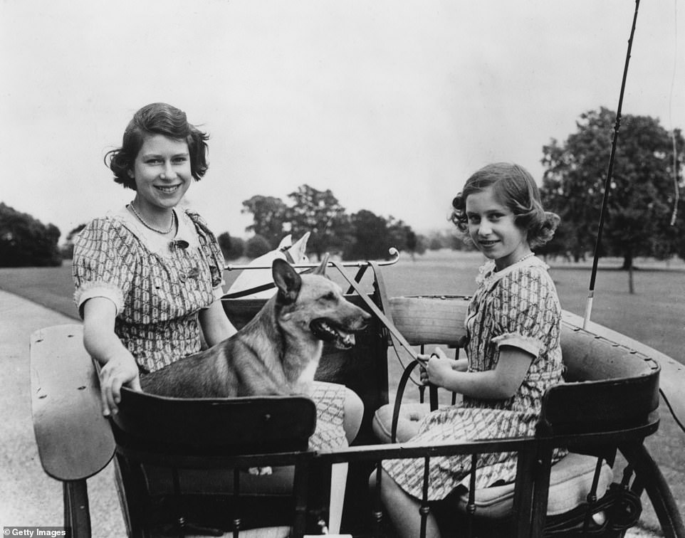 Queen Elizabeth (left) and her younger sister Princess Margaret in a carriage in the grounds of the Royal Lodge in Windsor in 1940
