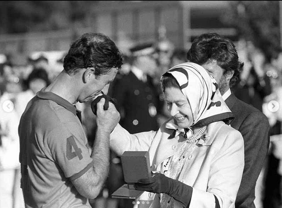 Prince Charles is presented with the runners-up prize by his mother, the Queen, following his team's defeat in the Silver Jubilee Cup match against France at Windsor Great Park onJuly 24, 1988 (the image was shared as part of the Clarence House tribute this morning)