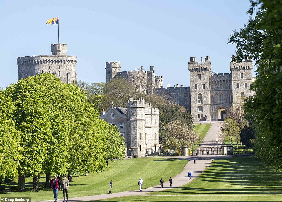 A large Royal Standard flies over Windsor Castle where the Queen celebrates her 94th birthday in isolation