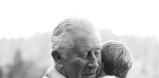 Prince Charles has released an unseen photo with Prince Louis to mark his grandson's second birthday today. The adorable black and white snap shows Charles smiling as he holds Louis to his chest. The young prince wraps his arms lovingly around his grandfather's neck
