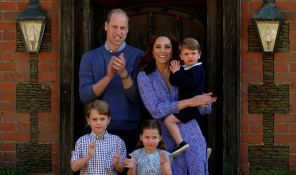 William, Kate and their three children, George, Charlotte and Louis, clapping for carersa