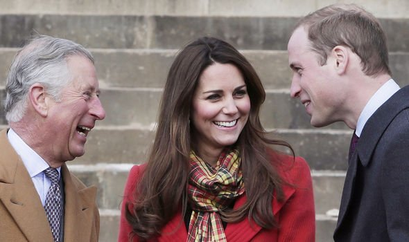 Charles pictured with Kate and William