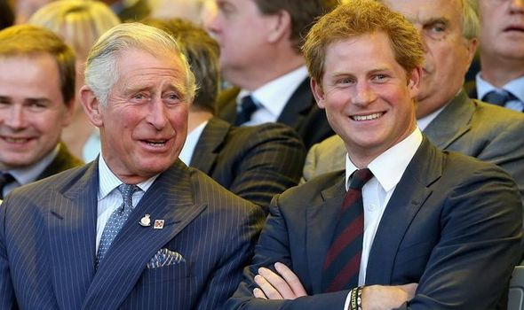 Prince harry and prince charles smiling together