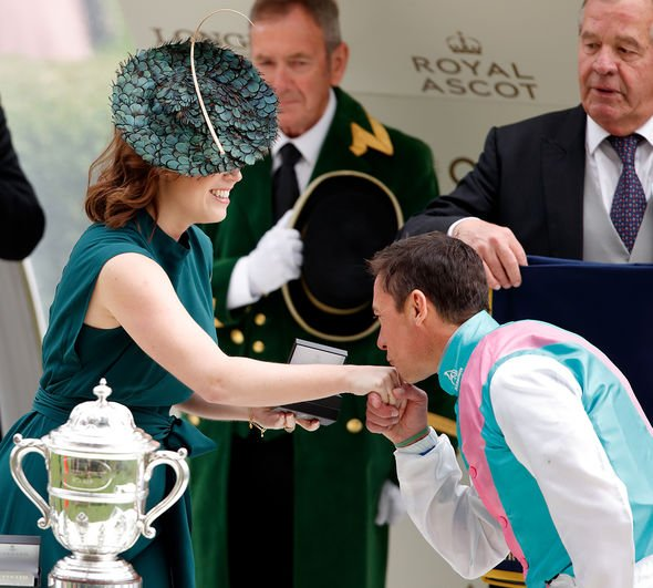 Jockey Frankie Dettori kisses Princess Eugenie's hand during the prize giving presentation after he won 'The Hampton Court Stakes' on day three, Ladies Day, of Royal Ascot at Ascot Racecourse