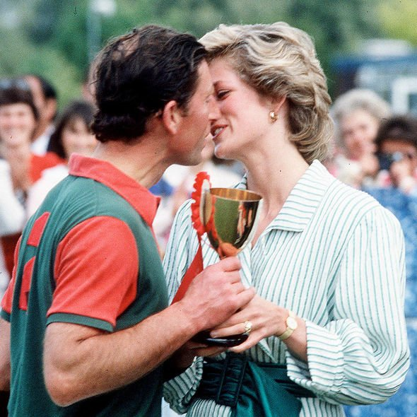 Prince Charles and Princess Diana kiss as he wins a match
