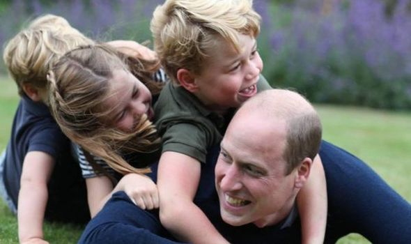Prince William posed with his three children in adorable new snap
