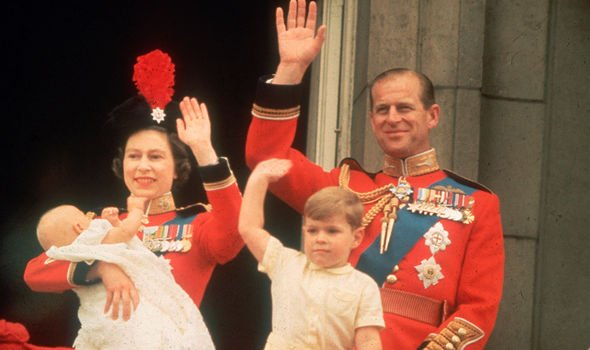 The Queen holding Prince Edward with Prince Andrew and Prince Philip at Trooping the Colour