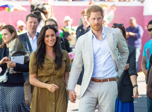The royal couple walk holding hands