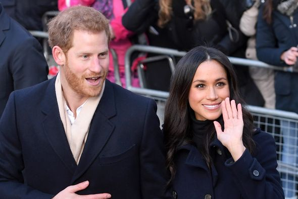 Meghan Markle and Prince Harry wave at cameras
