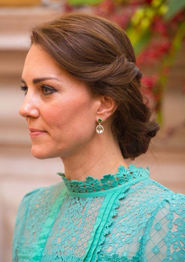 Kate Middleton wearing green earrings
