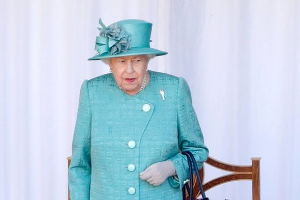 NHS clap: The Queen showed support for the NHS with the colour blue