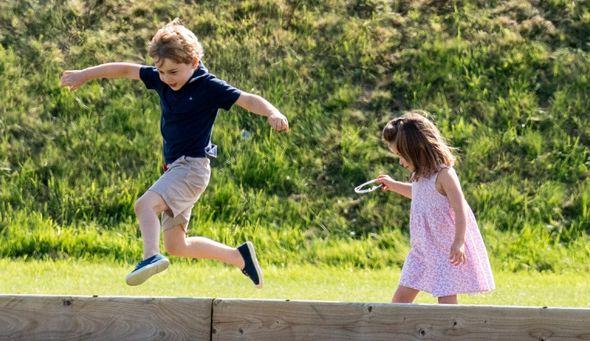 princess charlotte news prince george help royal family