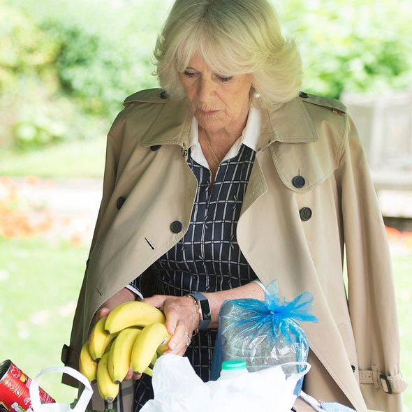 Camilla helping to pack food packages for Swindon Council