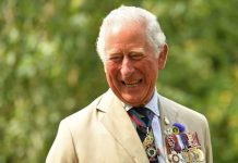 Prince Charles smiling at royal engagement