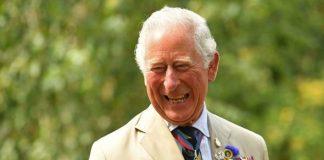 Prince Charles smiling at royal engagement