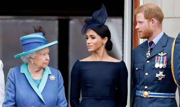 Queen Elizabeth II, Meghan Markle and Prince Harry on Buckingham Palace's balcony