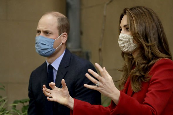 NHS: Kate talking to medical staff as she and William visit St Bartholomew's Hospital