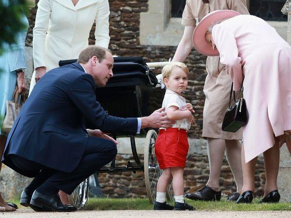 The Queen is seen gazing adoringly at the children's artwork