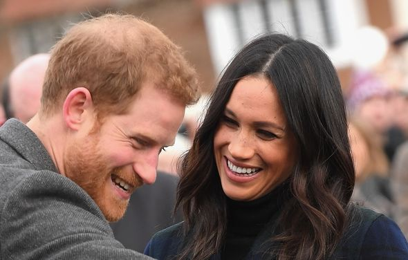 Prince Harry and Meghan Markle laughing