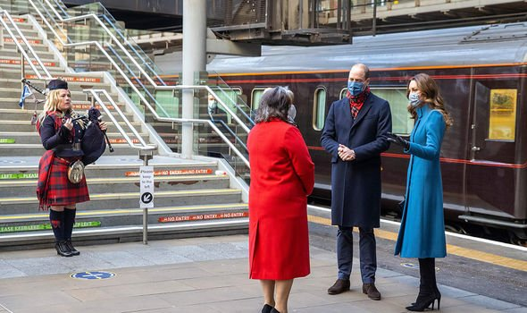 Prince William news: The Duke and Duchess of Cambridge in Edinburgh train station for their royal train tour, with the Lord Provost of Edinburgh's official piper Louise Marshall and Deputy Lord Lieutenant Sandra Cumming