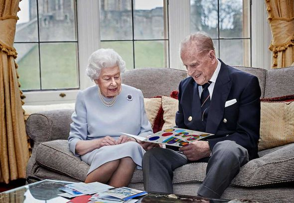 Royal Family: The pair open an anniversary card from the Cambridge children