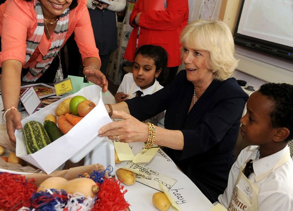 Duchess of Cornwall meeting school children during her visit to Godolphin Junior School in Slough.APRIL 24 2013