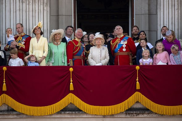 File photo dated 8/6/2019 of Queen Elizabeth II is joined by members of the royal family on the balcony of Buckingham Place watch the flypast after th