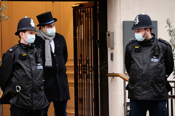 Police officers guard the King Edward VII Hospital, where Britain's 99-year-old Prince Philip, the Duke of Edinburgh, continues to receive medical care in London, England, on February 21, 2021.