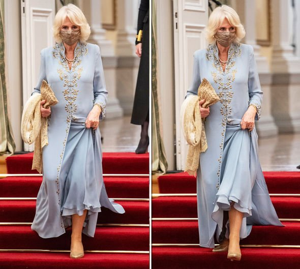 Camilla in Greece wearing a blue dress