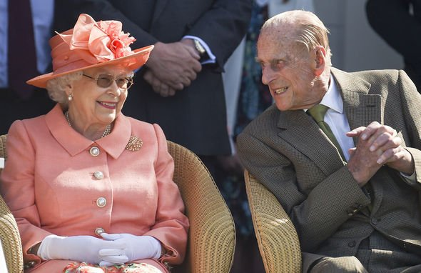 prince philip speaking to the queen