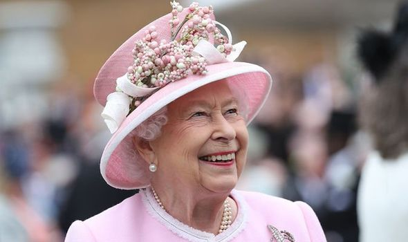File photo dated 29/05/19 of Queen Elizabeth II meeting guests during a Royal Garden Party at Buckingham Palace in London.