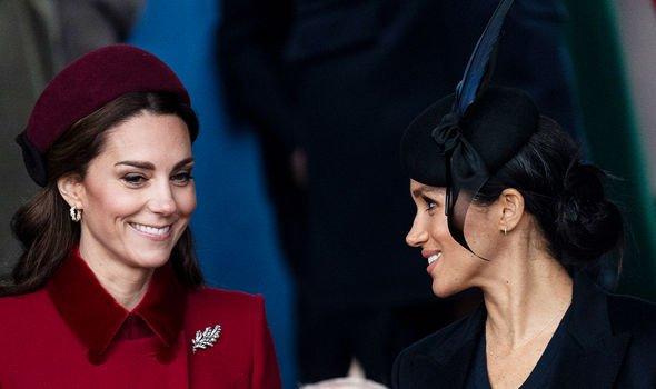 Kate and Meghan smiling together for Christmas 2018