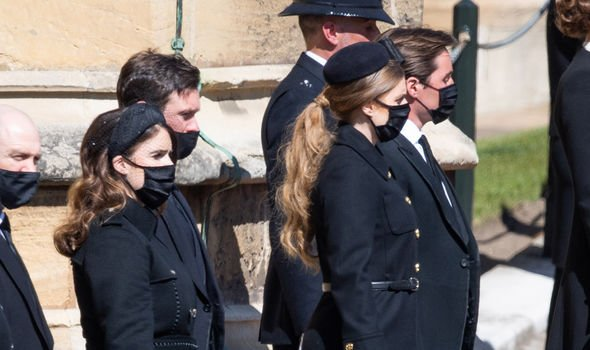 Beatrice and Eugenie with their husbands at Philip's funeral on Saturday