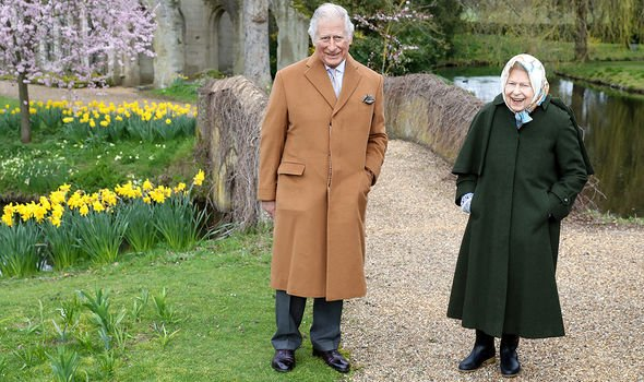 Prince Charles with the Queen on their walk