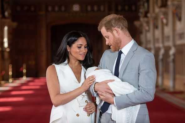 Harry and Meghan Markle hold baby Archie
