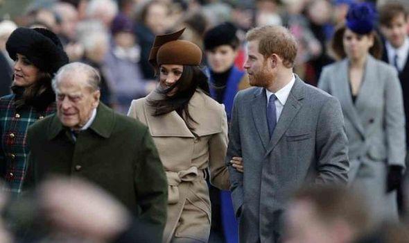 Prince Philip walks with Meghan Markle behind him