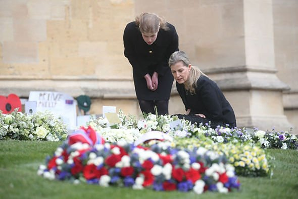 The Countess of Wessex (front) and Lady Louise Windsor view flowers outside St George's Chapel, at Windsor Castle, Berkshire, following the death of t